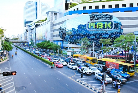 BANGKOK - APRIL 26 : Traffic at junction of the MBK shopping mall in Bangkok, Thailand as seen on APRIL 26, 2013.Over 100,000 people visit daily,make it one of the most popular spots in Bangkok.