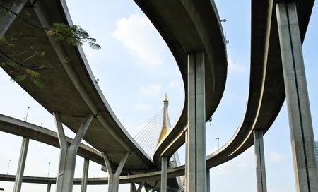 express lane: Elevated expressway. The curve of suspension bridge, Thailand. Stock Photo