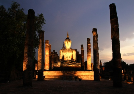 Ancient buddha statue at twilight, Wat Mahathat in Sukhothai Historical Park,Thailand. photo