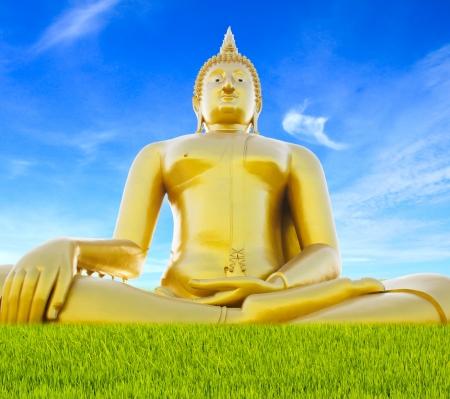 Big golden buddha statue against sky Stock Photo