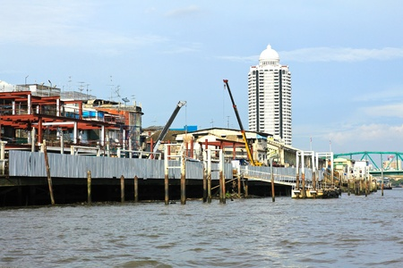 Residential buildings seen from boat along the Chao Phraya River in Bangkok , Thailand.
