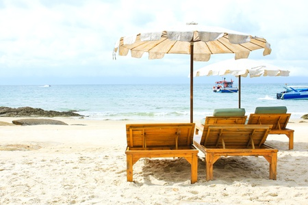 Beach chairs on tropical white sand beach photo