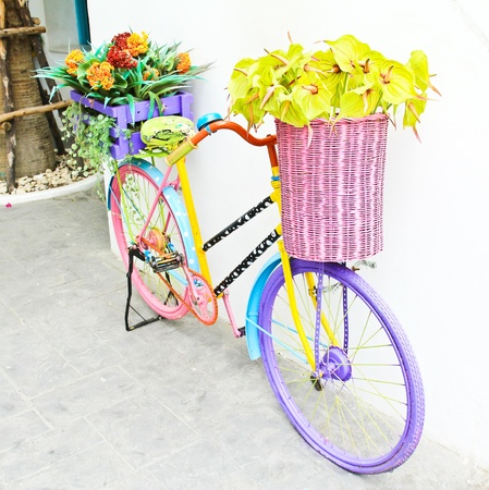 Artificial flowers and antique bicycle for decoration , Vintage style photo