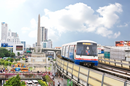 BANGKOK - SEP 16: A BTS Skytrain in the city on September 16, 2013 in Bangkok, Thailand. Each train of the mass transport rail network can carry over 1,000 passengers.