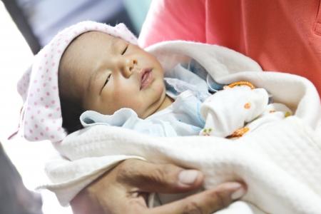 newborn baby girl: Newborn Asian baby girl sleeping Stock Photo