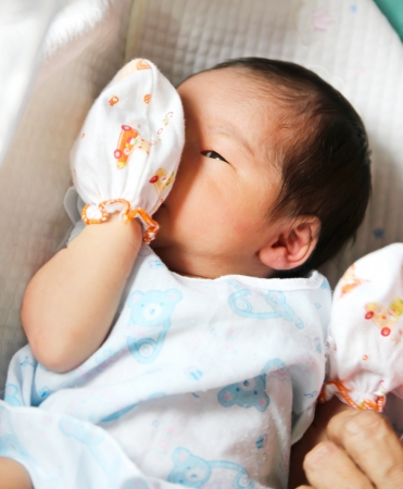 Newborn asian baby girl in hospital photo
