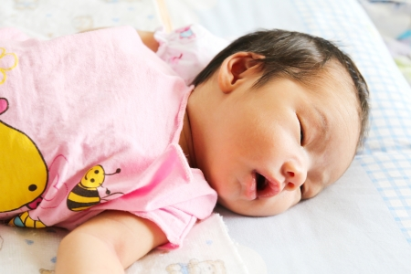 Newborn Asian baby girl sleeping photo