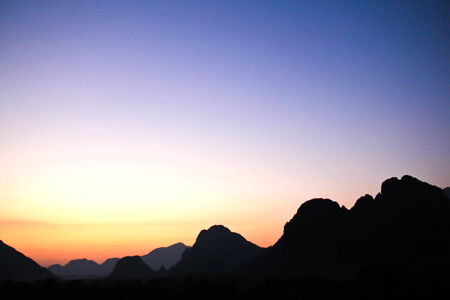 Beautiful sunset sky over the mountains photo