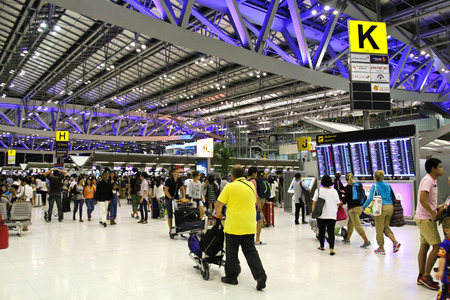 BANGKOK- AUGUST 15 : Passengers walking in Suvanaphumi Airport, Bangkok on August 15, 2014. Suvarnabhumi airport is worlds 4th largest single-building airport terminal.