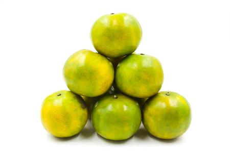 Fresh green tangerine isolated on white background.