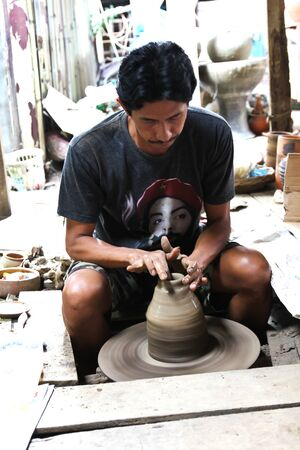 nonthaburi province: NONTHABURI - DECEMBER 27 : Hand carved pottery at Koh Kret island on December 27, 2015 at Nonthaburi province ,Thailand. Editorial