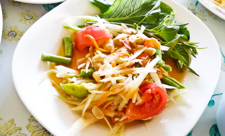 green bean: Thai papaya salad also known as Som Tum from Thailand.