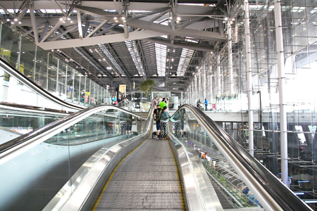 BANGKOK- FEBRUARY 17 : Unidentified people on terminal escalators of International Bangkok Airport on February 17, 2016, Suvarnabhumi airport is worlds 4th largest single-building airport terminal. Editorial