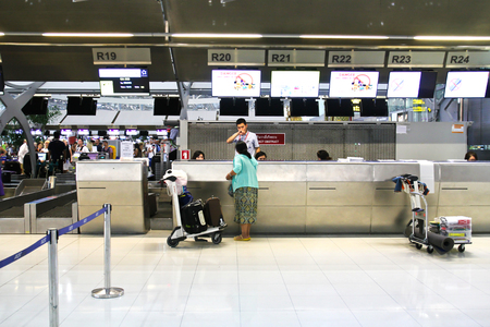 BANGKOK - FEBRUARY 17 : People waiting in check-in line R terminal of the Bangkok airport on February 17, 2016. Suvarnabhumi airport is worlds 4th largest single-building airport terminal.