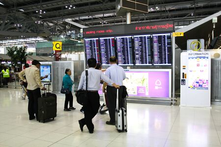 annually: BANGKOK - FEBRUARY 17: Travellers view a departures board at Suvarnabhumi International Airport on February 17, 2016 in Bangkok, Thailand. The airport handles 45 million passengers annually.