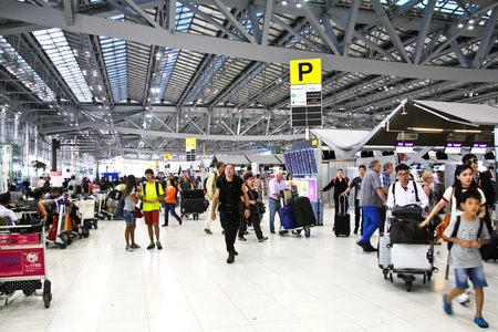 BANGKOK- FEBRUARY 17 : Passengers walking in Suvanaphumi Airport, Bangkok on February 17, 2016, Suvarnabhumi airport is worlds 4th largest single-building airport terminal.