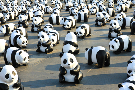 represent: BANGKOK,THAILAND - MARCH 4, 2016 : 1600 Pandas+ TH, Paper mache Pandas to represent 1,600 Pandas and to raise awareness in conservation and sustainable development for endangered animals in Thailand.