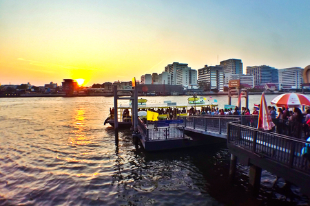 BANGKOK,THAILAND - MARCH 4, 2016: A pier for traveling along Chao Phraya River on regular city boat line, which serves over 50,000 passengers daily, Bangkok, Thailand
