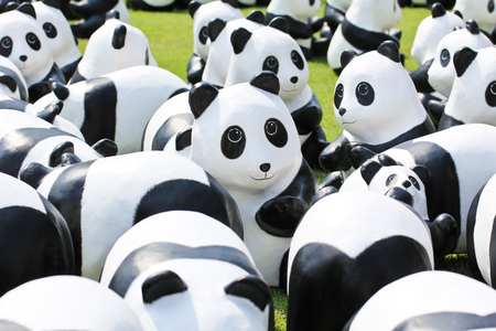represent: BANGKOK,THAILAND - MARCH 13, 2016 : 1600 Pandas+ TH, Paper mache Pandas to represent 1,600 Pandas and to raise awareness in conservation and sustainable development for endangered animals in Thailand.