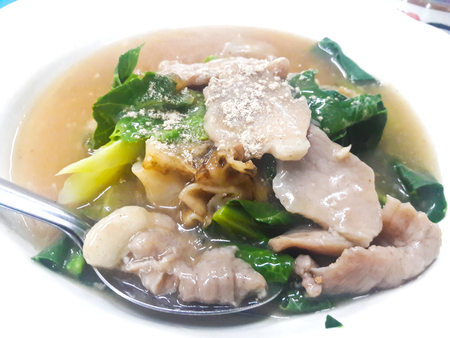 soaked: Fried noodle with pork and kale soaked in gravy Stock Photo