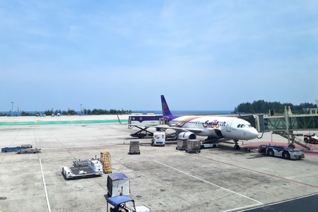 airway: PHUKET, THAILAND - May 3: Thai smile airway at Phuket International Airport on May 3, 2016. Thai smile airway plane is the low-cost airline in Thailand.