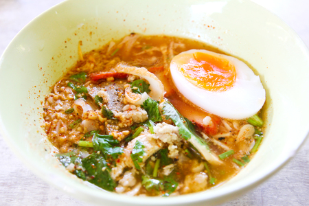 Thai style spicy noodle with egg.