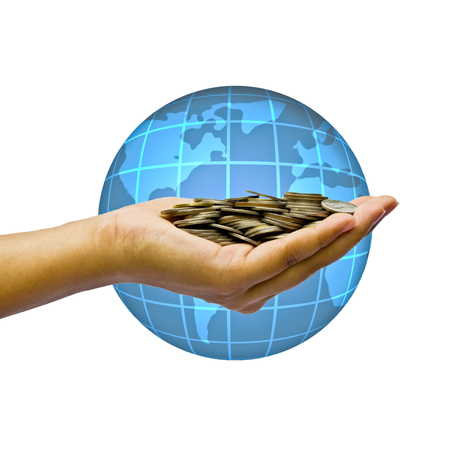 Global business concept. Hand and coins over globe.
