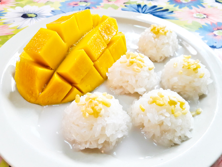 Thai style tropical dessert, sticky rice eat with mangoes