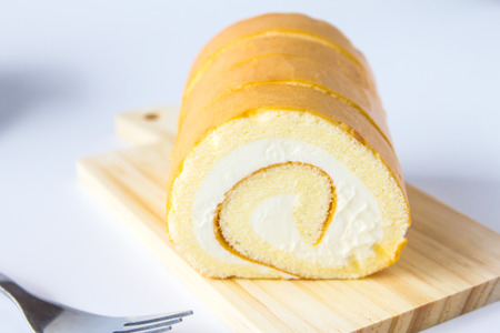 Swiss roll on white background. Фото со стока