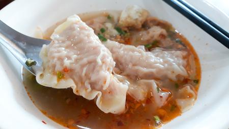 Thai wonton dumpling in spicy soup. Stock Photo