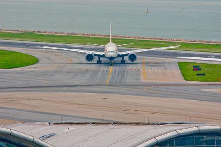 Landing Plane in Hong Kong International Airport photo