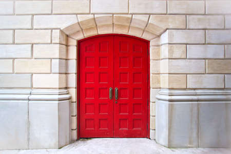 Red door on white brick background photo