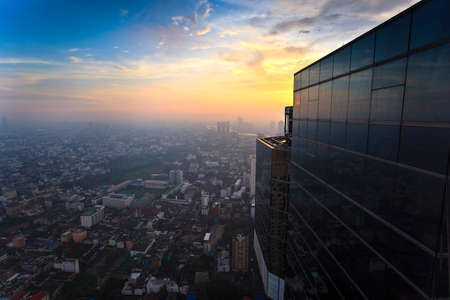 Top view building sunset time in the middle of Bangkok of Thailand