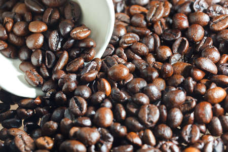 Fragrant fried coffee beans  as background photo