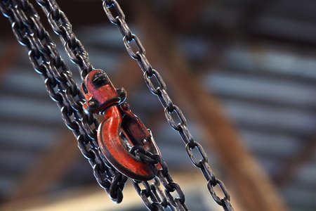Chain and Red hoist on background Stock Photo