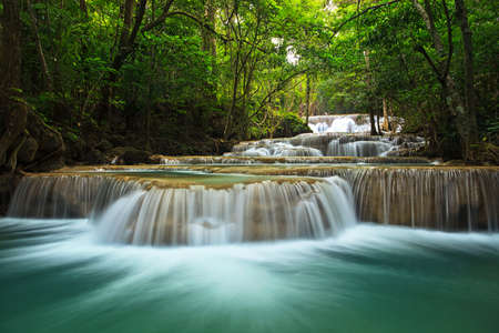 rock creek: waterfall in thai national park. In the deep forest on mountain.