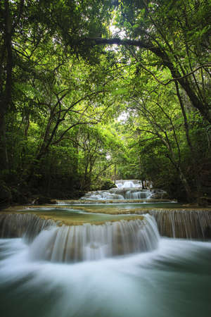 waterfall in deep forest of Thailand photo