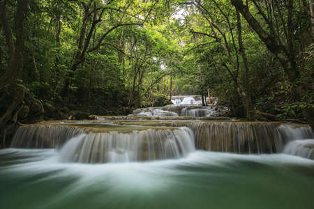 background nature: Water fall in spring season located in deep rain forest jungle