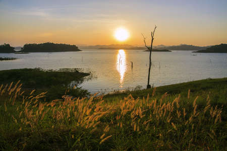 Summer landscape  beauty sunset over the river photo