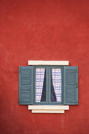 Vintage window and red wall photo
