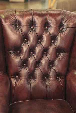Closeup texture of vintage black leather sofa for background Stock Photo