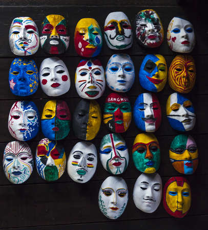pinwheels: Various style mask painting on wooden background