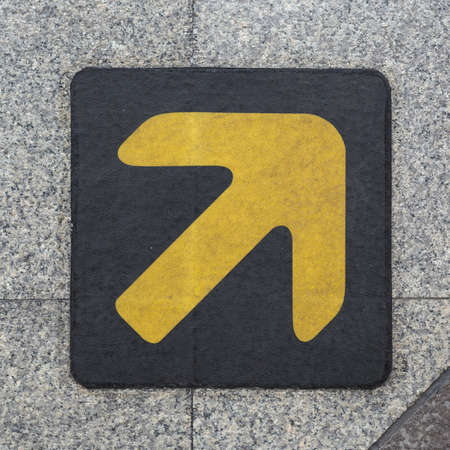 Yellow arrow on the ground photo