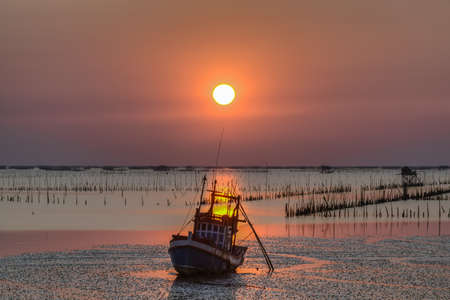 Fishing boat sunset at Bangsai beach Chonburi Stock Photo