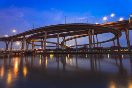 woody bay: Sunset mega bridge and river reflect