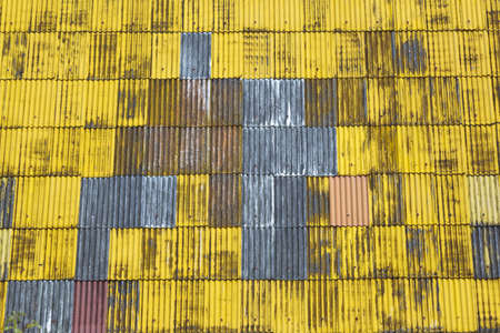 Texture background of yellow corrugated roof. photo