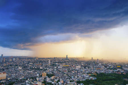 View of a raining over cityscape