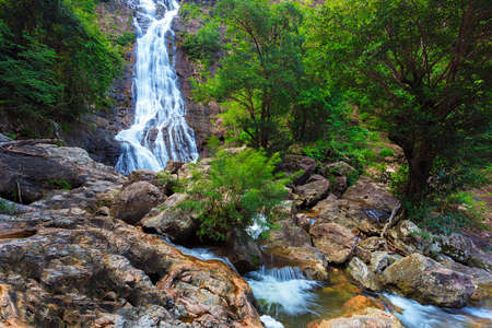 Waterfall in thai national park  In the deep forest on mountain  photo