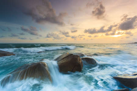 Rock and seascape at sunset time photo
