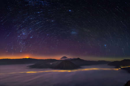 blue stars: Startrail from top of mountain Stock Photo